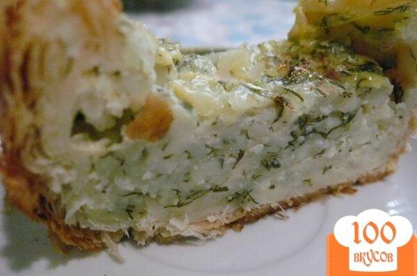 Фото рецепта: «Пирог из слоеного теста с начинкой из зерненого творога»