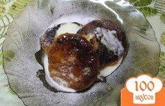 Фото рецепта: «Сырники тушеные в сметанном соусе»