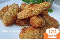 Фото рецепта: «Пикантные картофельные дольки»