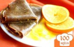 Фото рецепта: «Шоколадные блины с апельсиновым соусом»