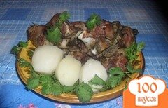 Фото рецепта: «Запеченная свиная рулька с кинзой»