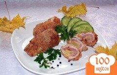 Фото рецепта: «Рулетики куриные с ветчиной и ананасом»