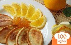Фото рецепта: «Апельсиновые оладьи на ряженке»