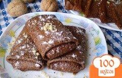 Фото рецепта: «Шоколадные блинчики с начинкой запеченные в духовке»
