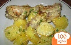 Фото рецепта: «Сочная курица с картофелем в рукаве»