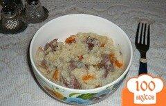 Фото рецепта: «Рисовая каша с куриными желудочками»