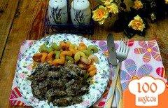 Фото рецепта: «Куриные сердечки с шампиньонами»
