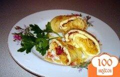 Фото рецепта: «Рулет из омлета с вялеными помидорами и сыром»